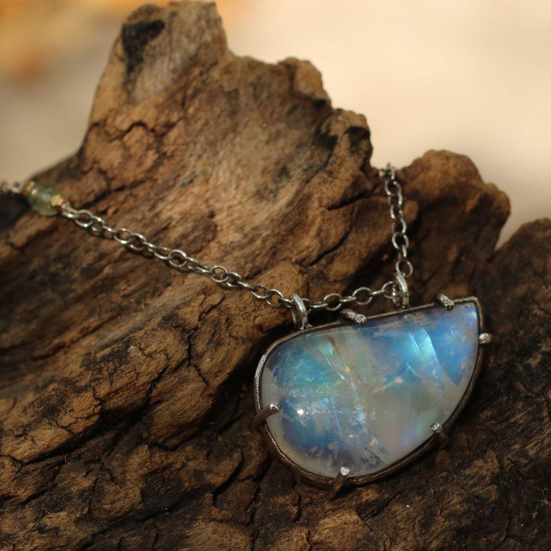 Moonstone pendant necklace set in silver bezel setting metal