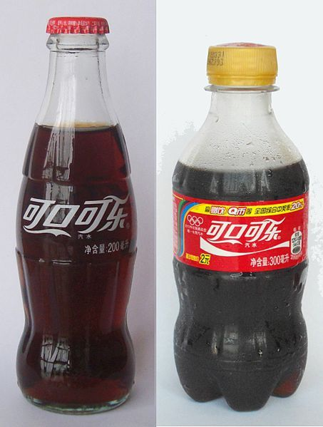 Two Chinese Coke bottles, a 200 ml glass bottle, which is becoming less common, and a 300 ml plastic bottle that is now widely available.