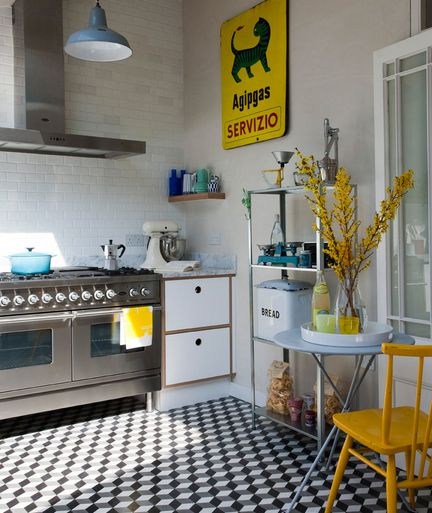 Art, tiles, freestanding furniture all help out small spaces