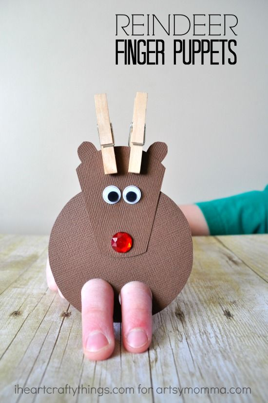 Adorable DIY Reindeer Finger Puppets is part of Christmas crafts, Preschool christmas, Puppet crafts, Christmas crafts for kids, Holiday crafts, Xmas crafts - I have such fond memories of watching the classic Rudolph the RedNosed Reindeer movie as a kid  Do you  When I see it on TV around the holidays my heart delights and we probably watch