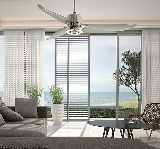 A silver ceiling fan in a contemporary living room with water views.