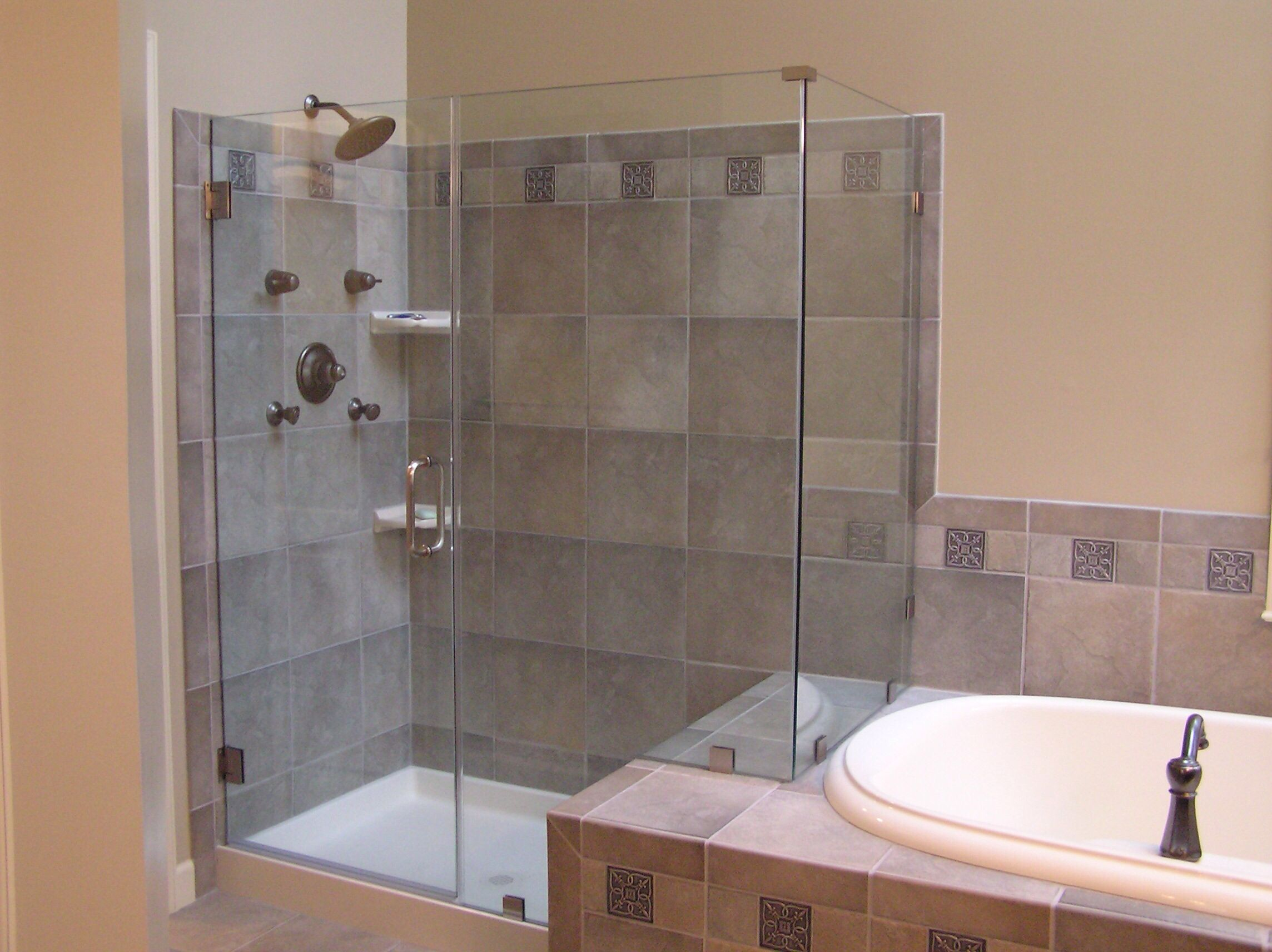 Love the idea of using the edge of the tub as the bench in the shower... Very clever use of the space...