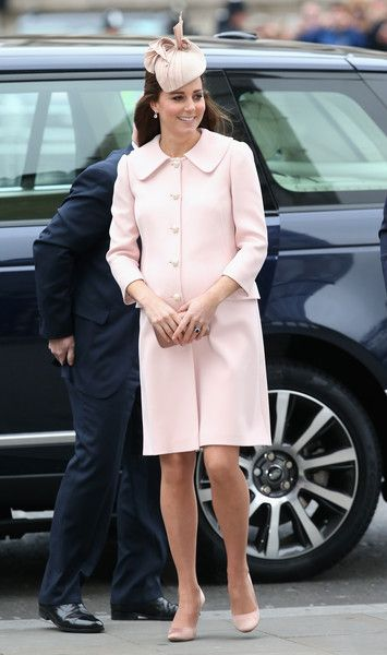 Kate Middleton in pink satin pumps paired with an Alexander McQueen coat.
