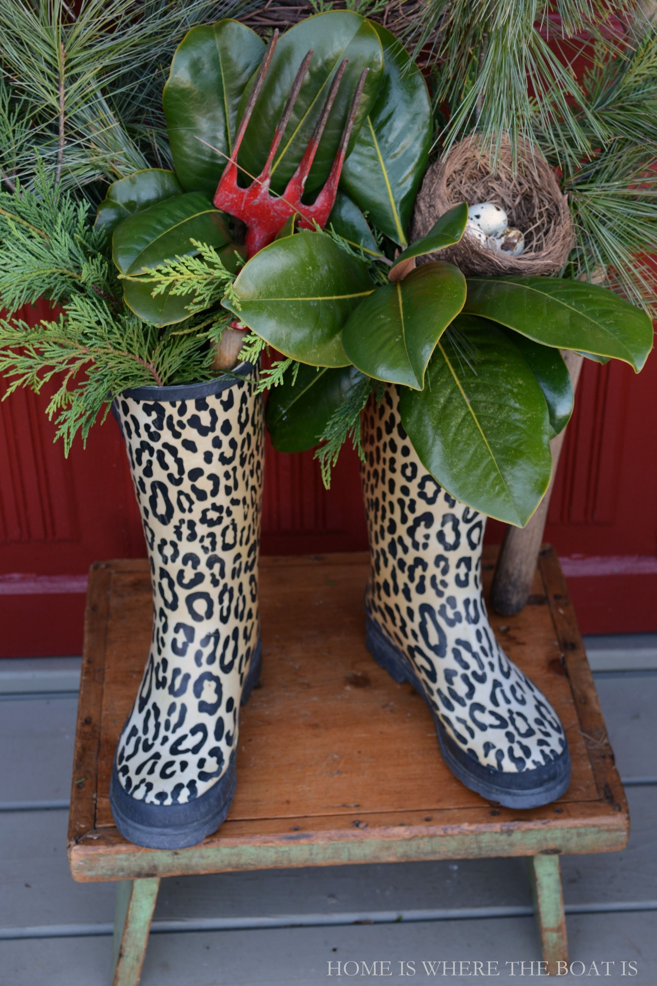 wellies with winter greenery garden fork and bird nest home is