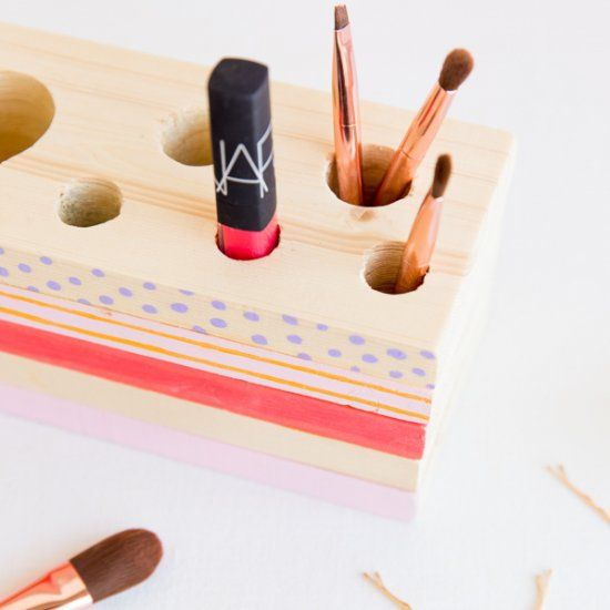 Keep all of your makeup and beauty tools tidy with this reversible wood organizer DIY.