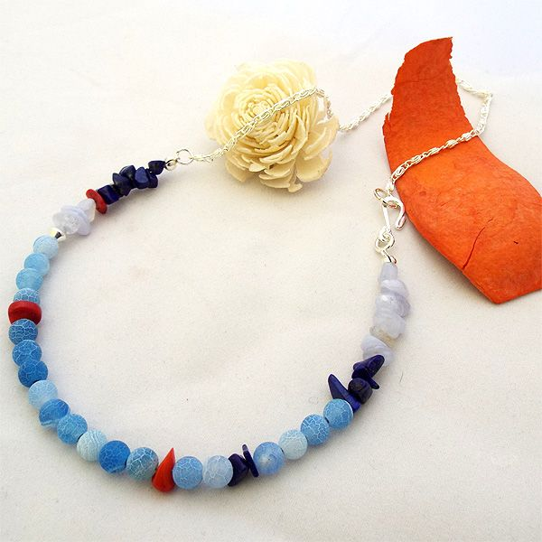 """Handmade gemstone necklace. Lovely blue themed necklace with Lapis Lazuli and red coral chips and blue crackle agate gemstones. The necklace is finished off with a quality silver plated chain and S-lariat style clasp. Nickel free and hypoallergenic friendly. Available in 18"""", 20"""" and 22"""" sizes. Additional sizes available upon request. Sale - only £18."""