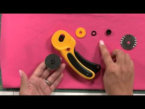 Learn how to change the blade of your Olfa Deluxe Handle rotary cutter in a few simple steps. This rotary cutter that's available on JOANN features a curved handle and squeeze mechanism for safety. Turn the rotary cutter, remove the nut, washer and spacer, pull the blade stem, change to a new sharp straight or decorative blade and put the components back together. Use the rotary blade cutter to create lovely decorative quilting projects.