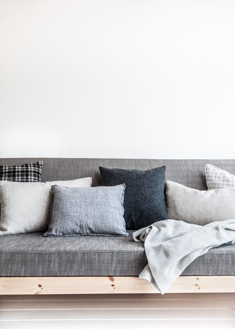 Minimal Sofa With Lots Of Pillows For A Perfect Relaxing Moment