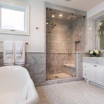 large gray marble tiles on bottom half of bathroom walls
