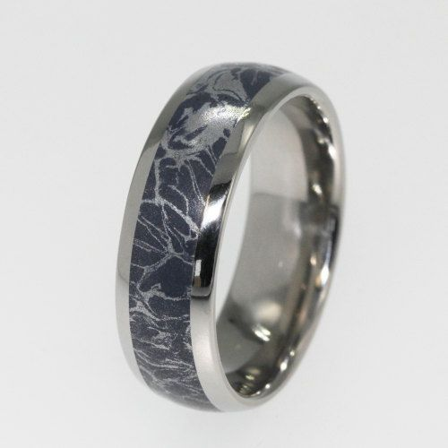 "This Titanium Band is inlaid with a Blue Bronze and Galactic Silver Mokume Gane.  Mokume Gane is a mixed-metal laminate with distinctive layered patterns. Translating as ""wood-grain metal"", the name w"