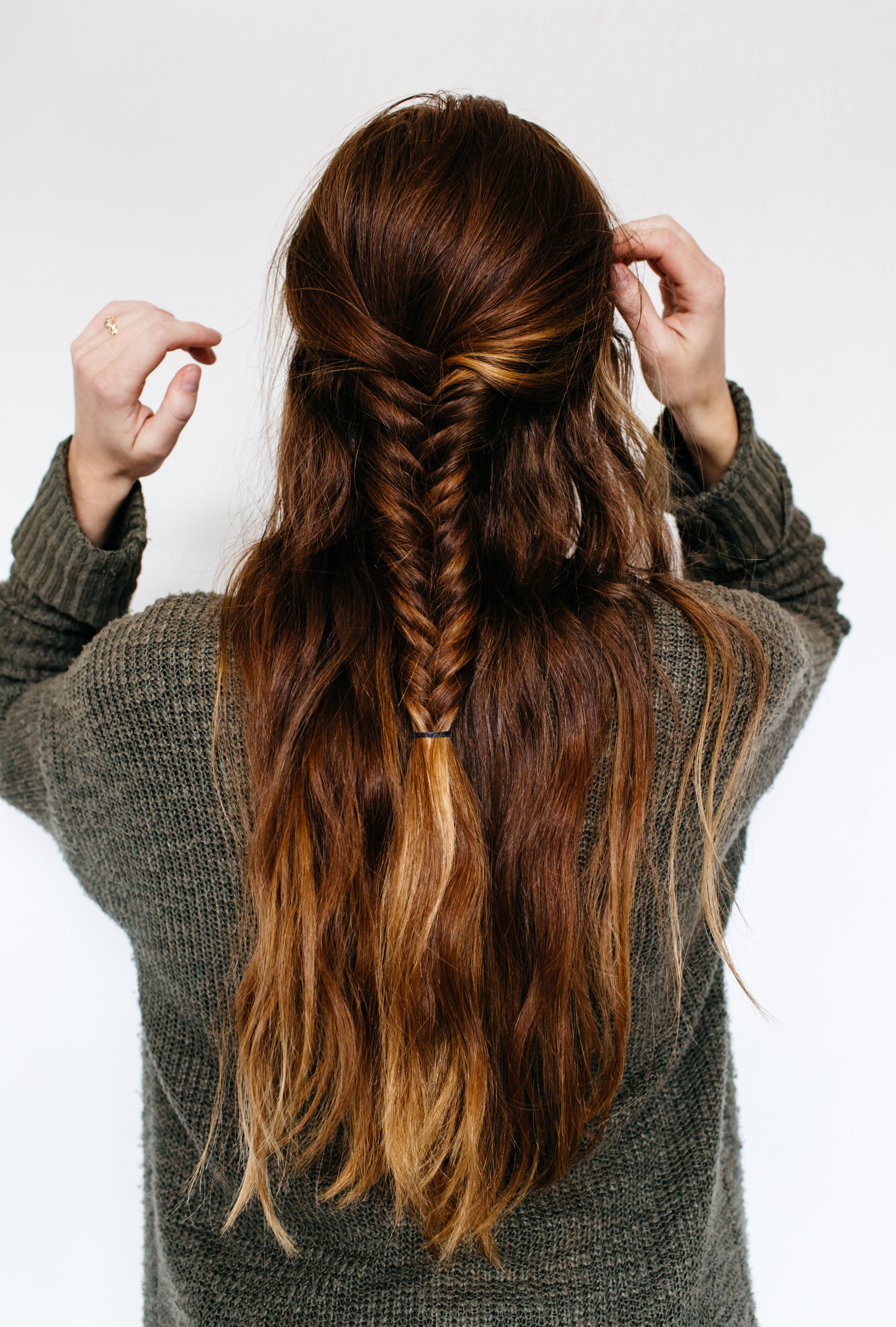 Half up half down fishtail braid hairstyle for thick medium length