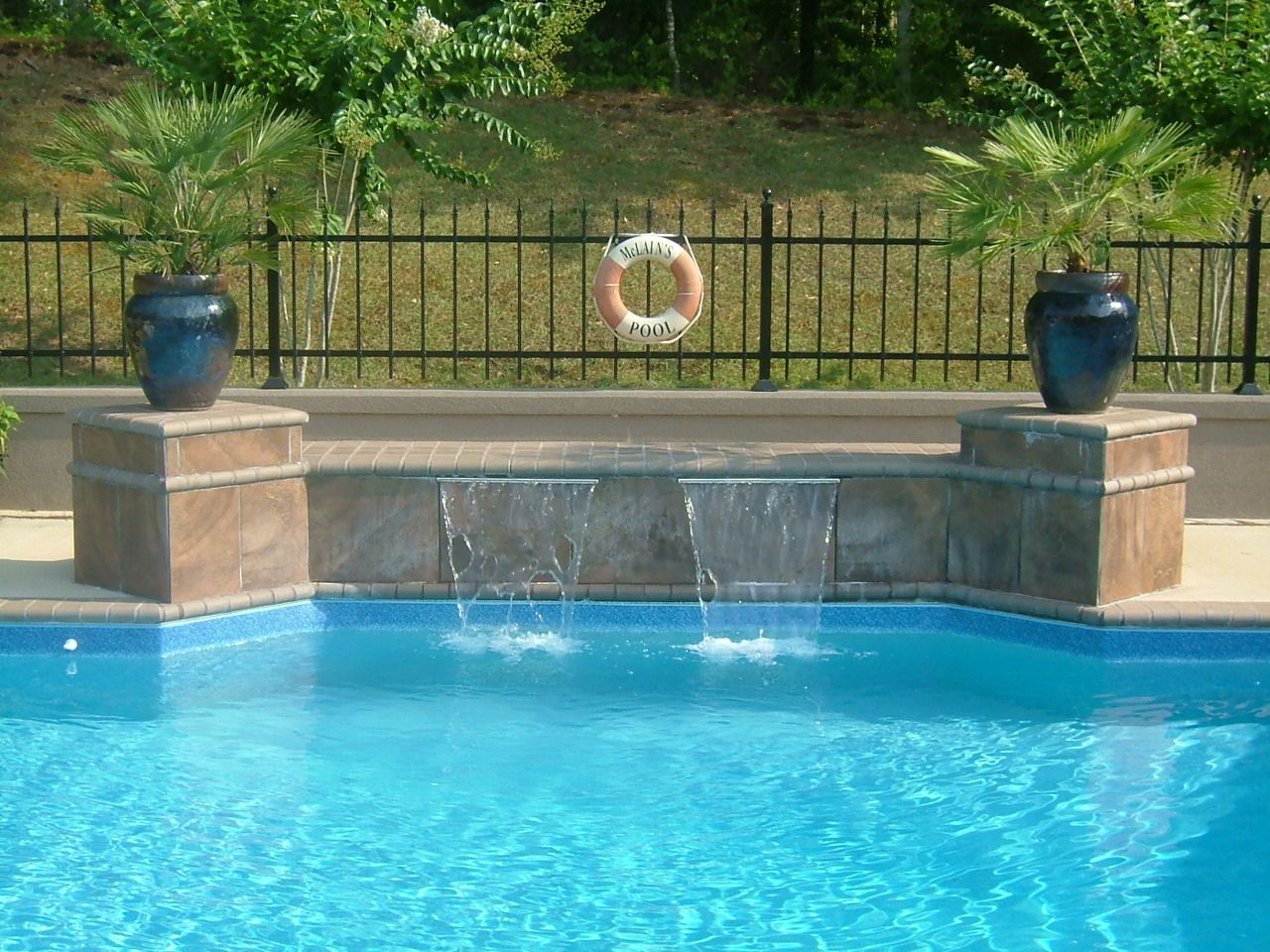Waterfall On Pools Google Search Swimming Pool Waterfall Swimming Pools Backyard Inground Inground Pool Designs