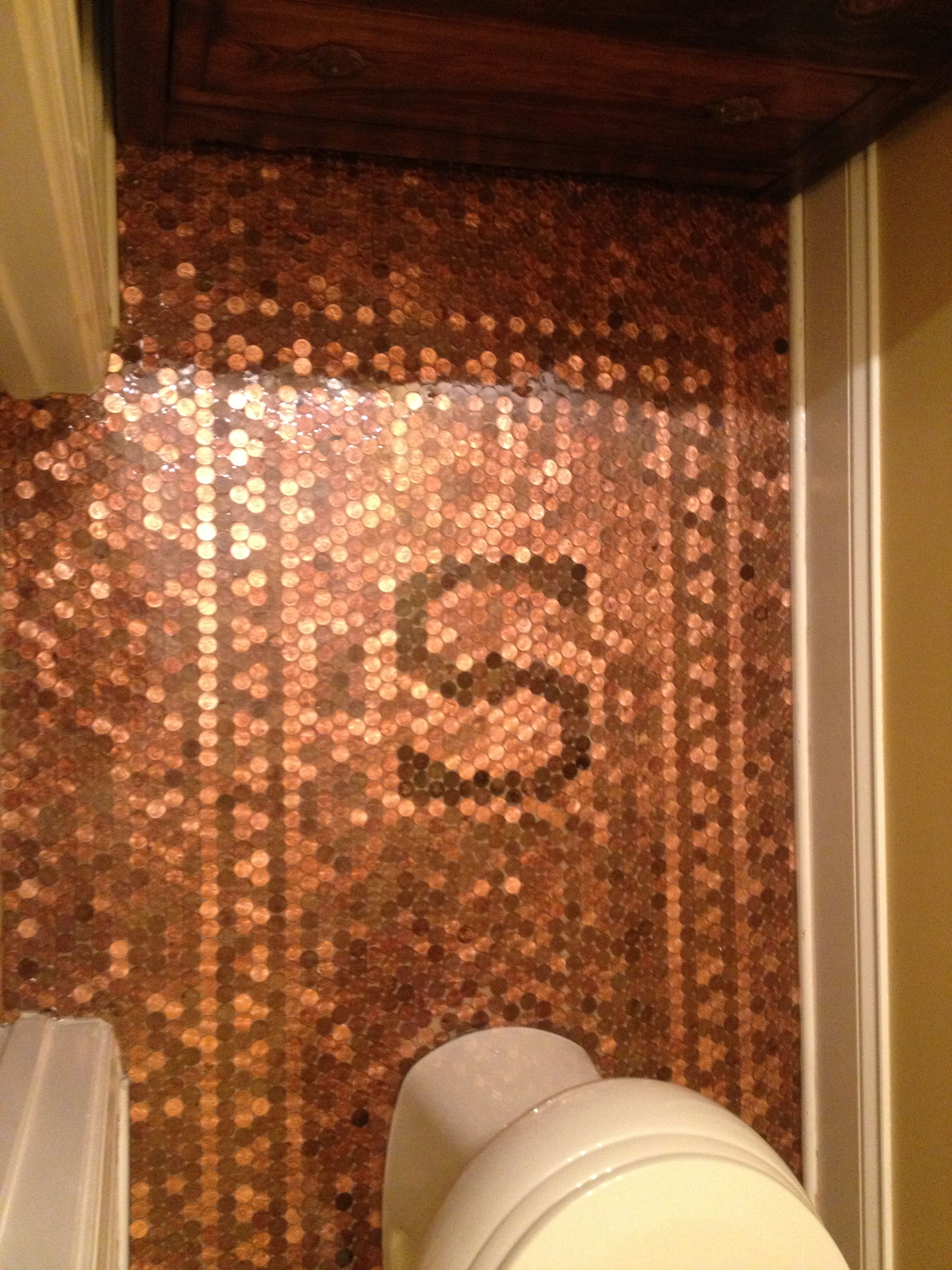 Finished product penny floor complete with family initial for How to make a penny wall