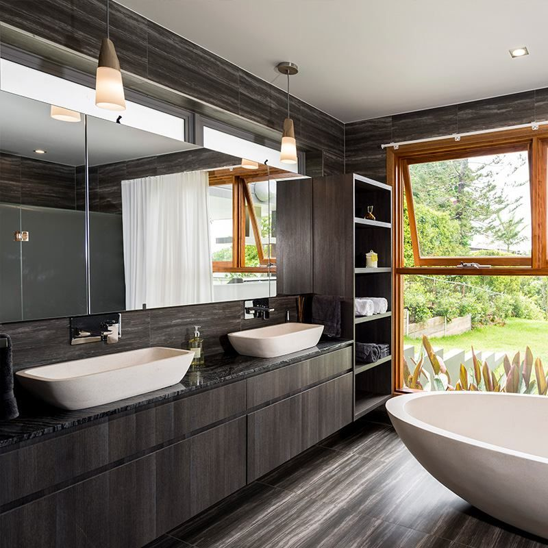 A Beautiful Open Bathroom Overlooking Bright Greenery With