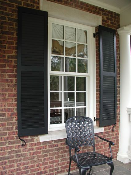 Louvered Shutters with brick mold mount and tie backs