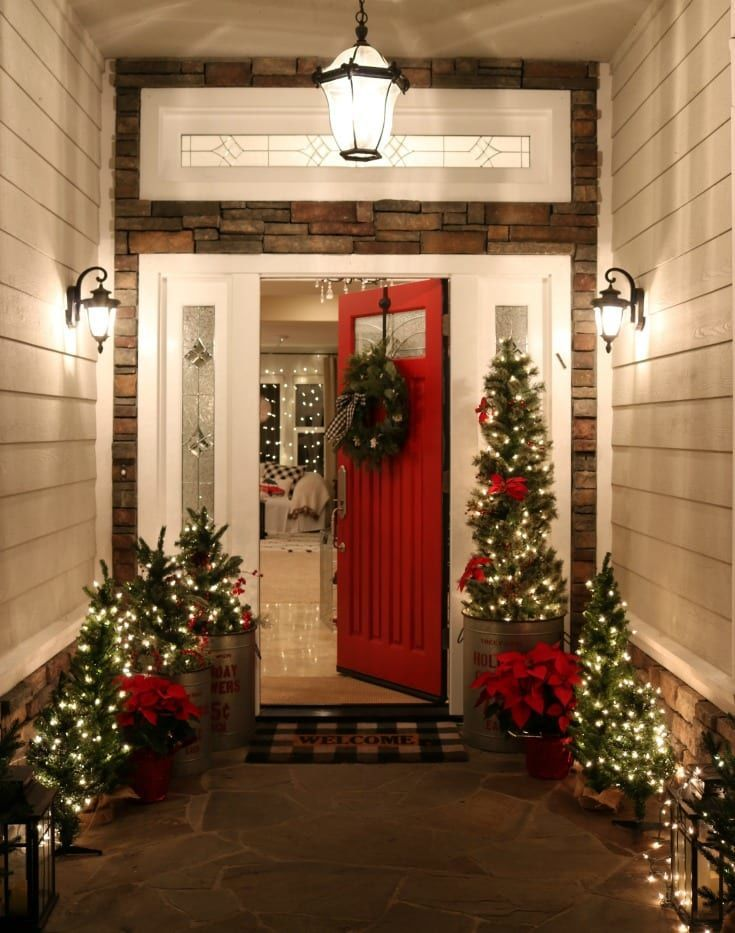 10 MORE stunning Christmas front porches that are sure to get you in the holiday spirit. Featuring: Buffalo Check Christmas Front Porch -by The Design Twins. #Christmas #FrontPorch #Porch #ChristmasDecor #ChristmasDecorations #ChristmasHouse #Holiday #HolidayDecor #Home #House #HomeDecor