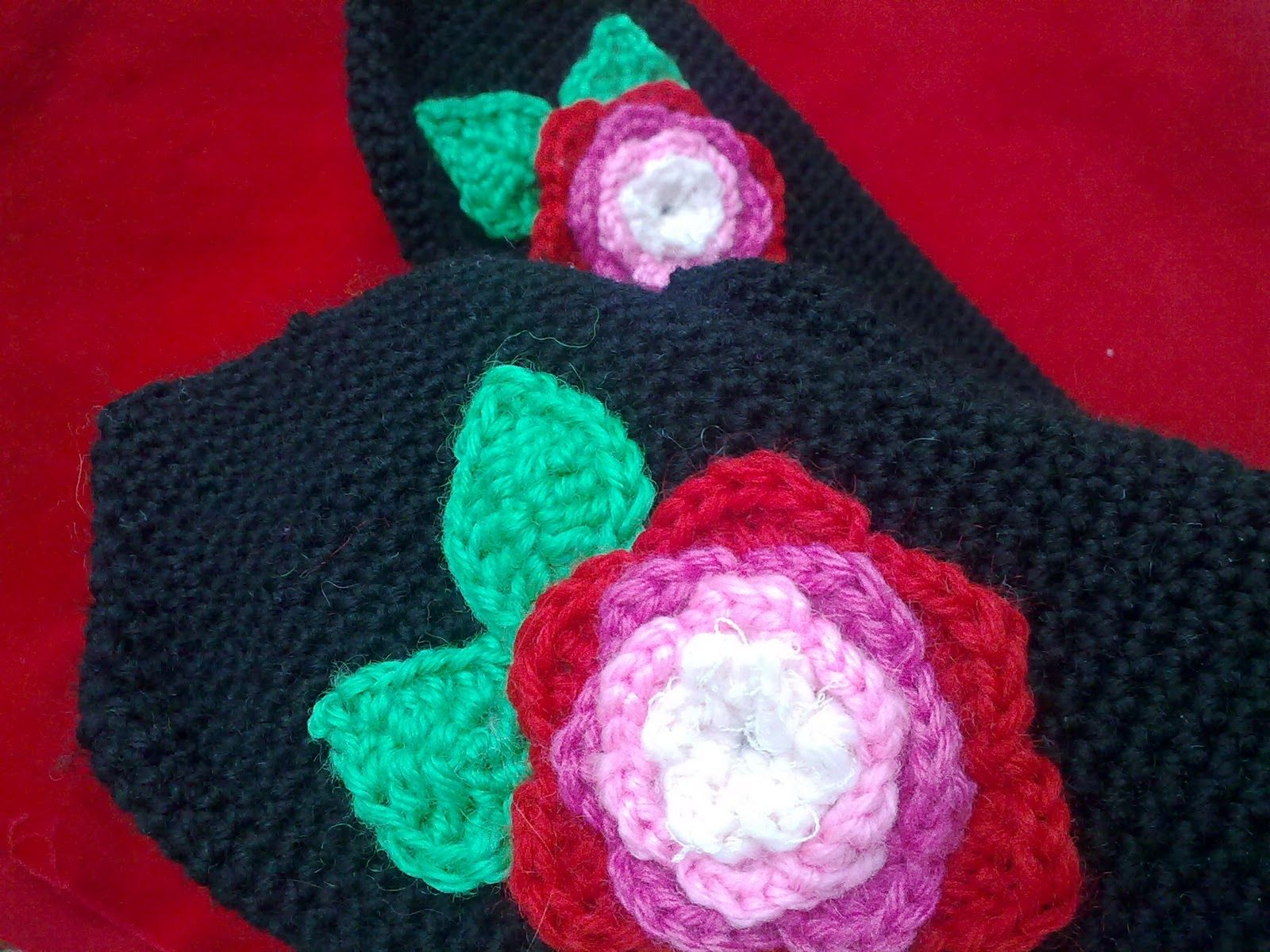 Crocheted rose mittens