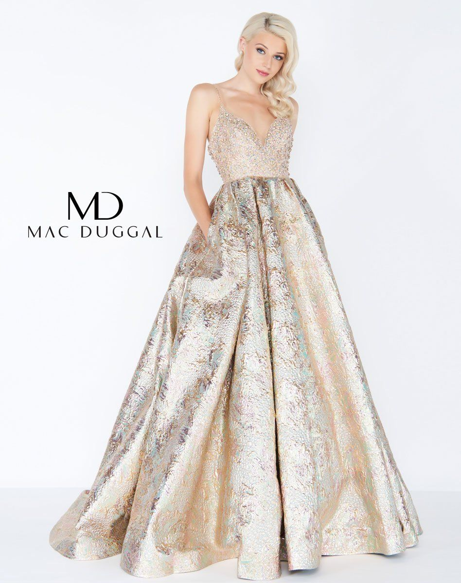 8878fcc4bdf Mac Duggal prom dress. Exquisite v-neck prom gown embellished with  multi-colored beaded bodice and straps. The ornately beaded bodice gives  way to a full ...