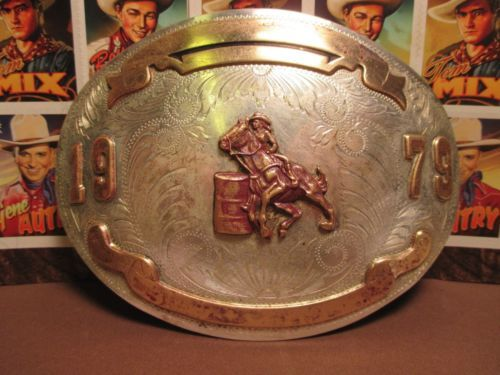 1979-COMSTOCK-SOLID-STERLING-SILVER-Front-Barrel-Racing-Belt-Buckle$295 or -MAKE-OFFER We are OLDWEST on eBay and have over 1200 vintage belt buckles listed us. Here is the link: http://stores.ebay.com/OWN-A-PIECE-OF-THE-OLDWEST E-Mail us at saddlerestoration@hotmail.com