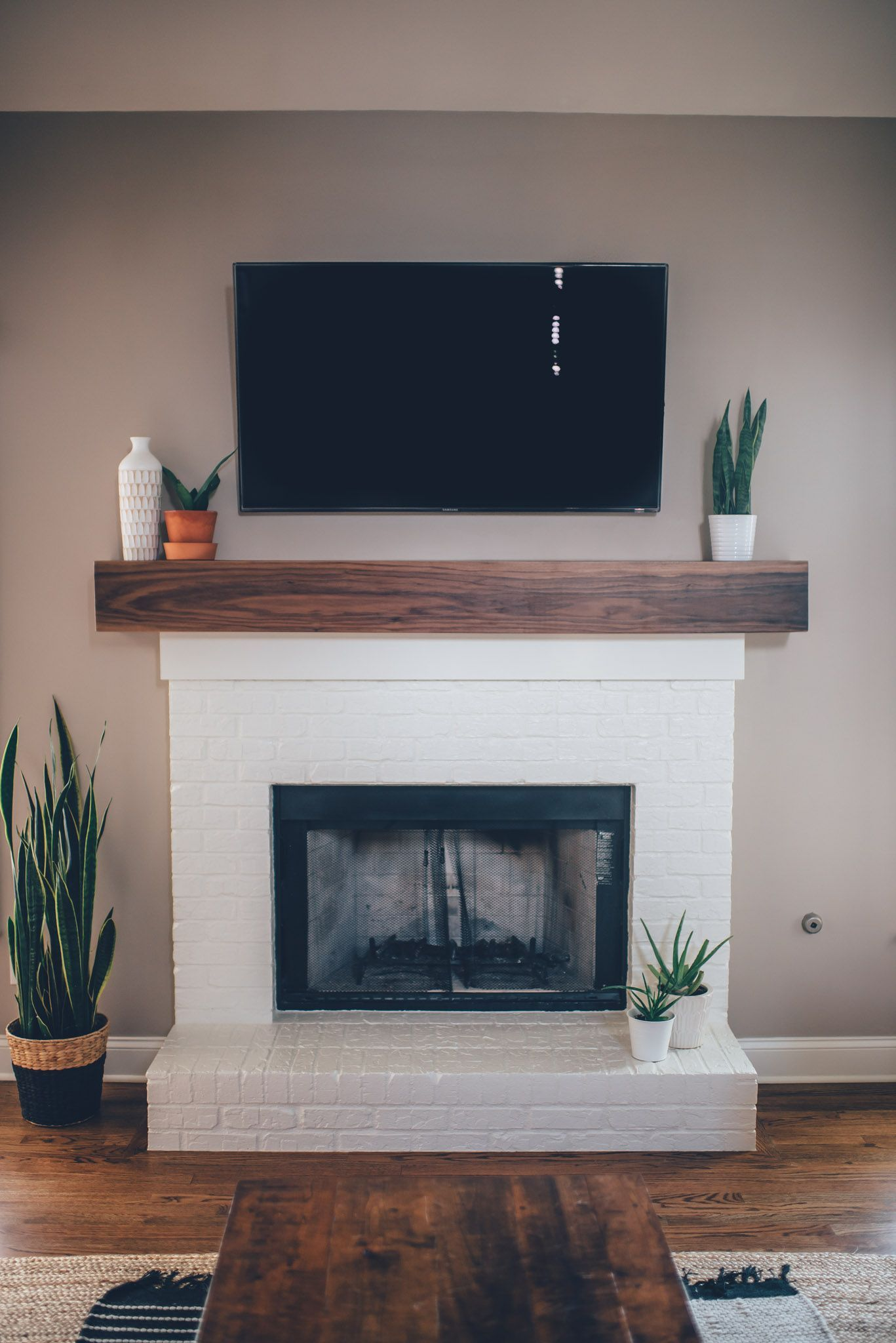 Modern White Brick Fireplace & Walnut Mantel DIY #whitebrickfireplace Modern White Brick Fireplace & Walnut Mantel DIY – The Southern Trunk #whitebrickfireplace