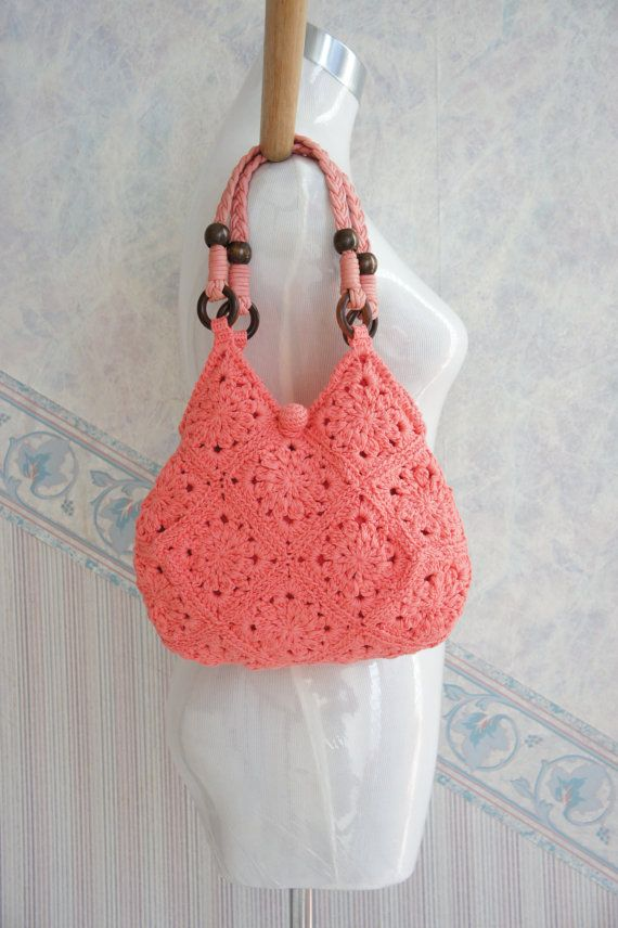 Coral Pink Hand Crochet Bag with Braided Leather by lecocopink.  (Link was removed.  Inspiration.)