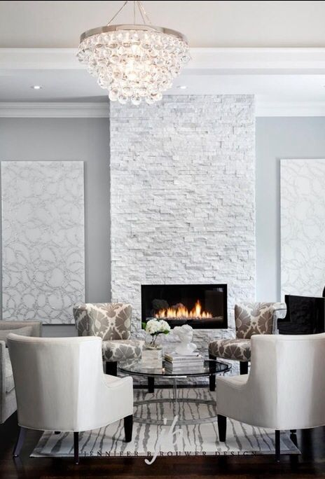 Floor to ceiling stone fireplace is to die for Love the artwork as well  Home decor in 2019