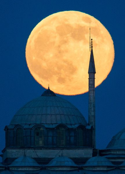 "A ""super moon"" rises behind a building of the Topkapi Palace in Istanbul, Turkey on Sunday, June 23, 2013. The moon, which will reach its full stage on Sunday, is expected to be 13.5 percent closer to earth during a phenomenon known as a ""super moon"". The ""super moon"" happens only once this year as the moon on its elliptical orbit is at its closest point to earth 