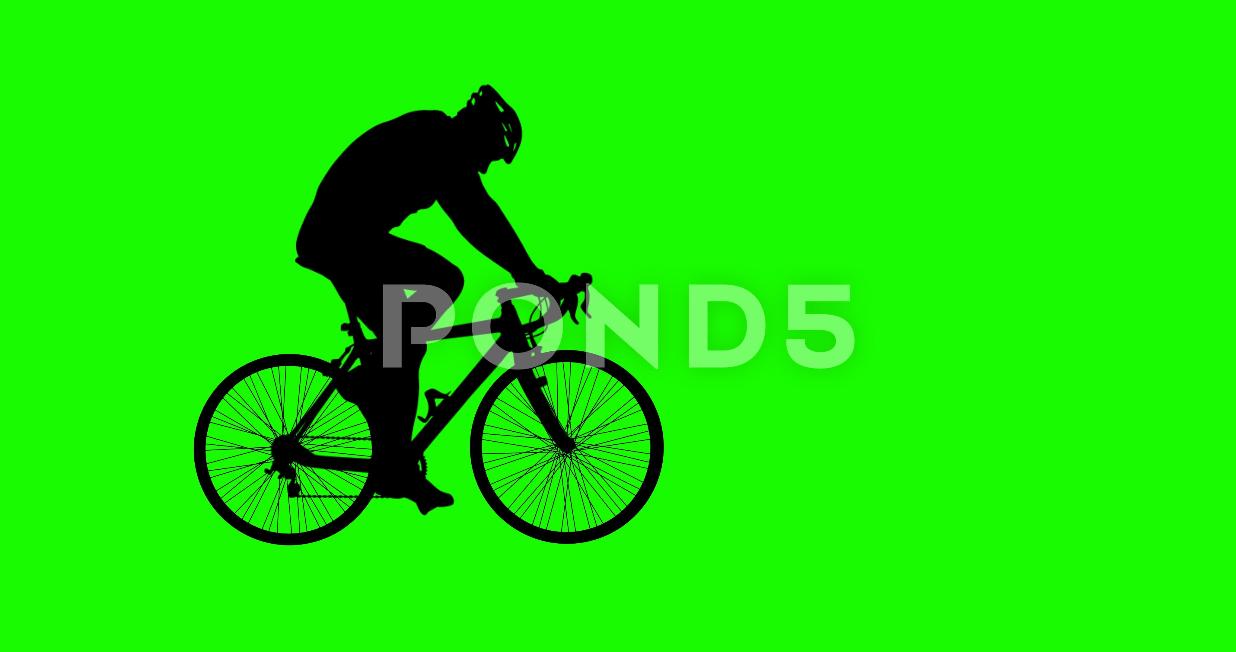 Biker passing through the screen from left to right. Green