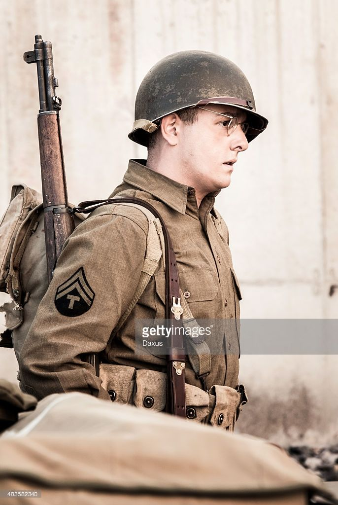 Soldier Relaxing with Rifle on his shoulder - WWII era - Stock Image