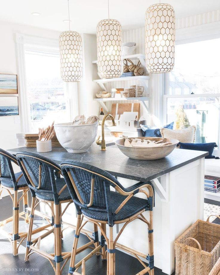 LOVE these blue woven counter stools at this kitchen