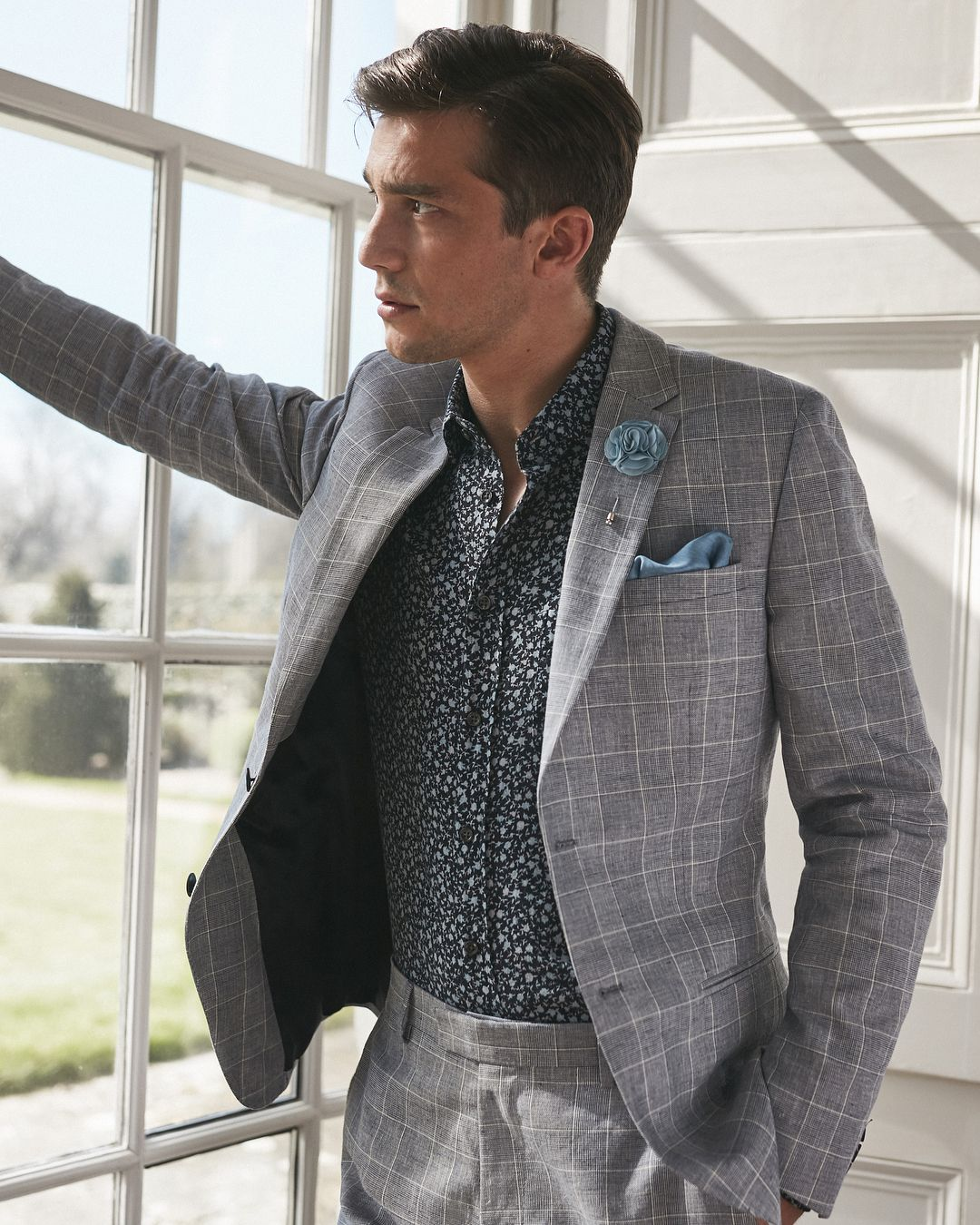 82e2974241552 Command your summer occasions in a check suit. Style it with a floral shirt  and tonal accessories for a look that s more ostentatious and…