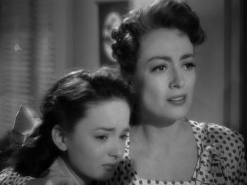 viaallrightmrdemille:    Ann Blythe & Joan Crawford, Mildred Pierce(Michael Curtiz, 1945)
