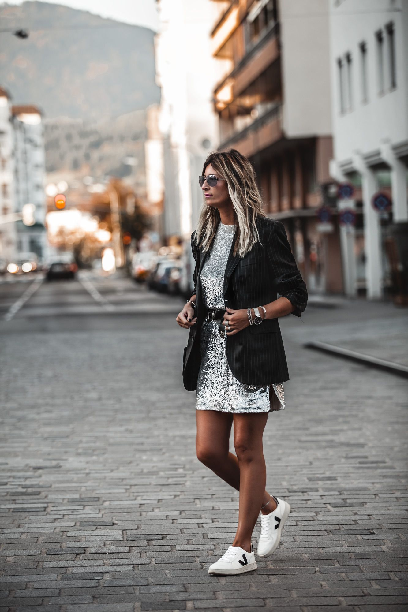 How To Dress Down A Sequin Dress Outfit Idea If You Want To Recreate This Look Try The Following Tips Dress And Sneakers Outfit Sequin Dress Outfit Fashion [ 2000 x 1333 Pixel ]