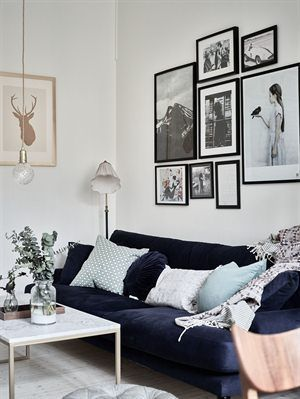 neutral living room styling with black and white gallery wall behind ...