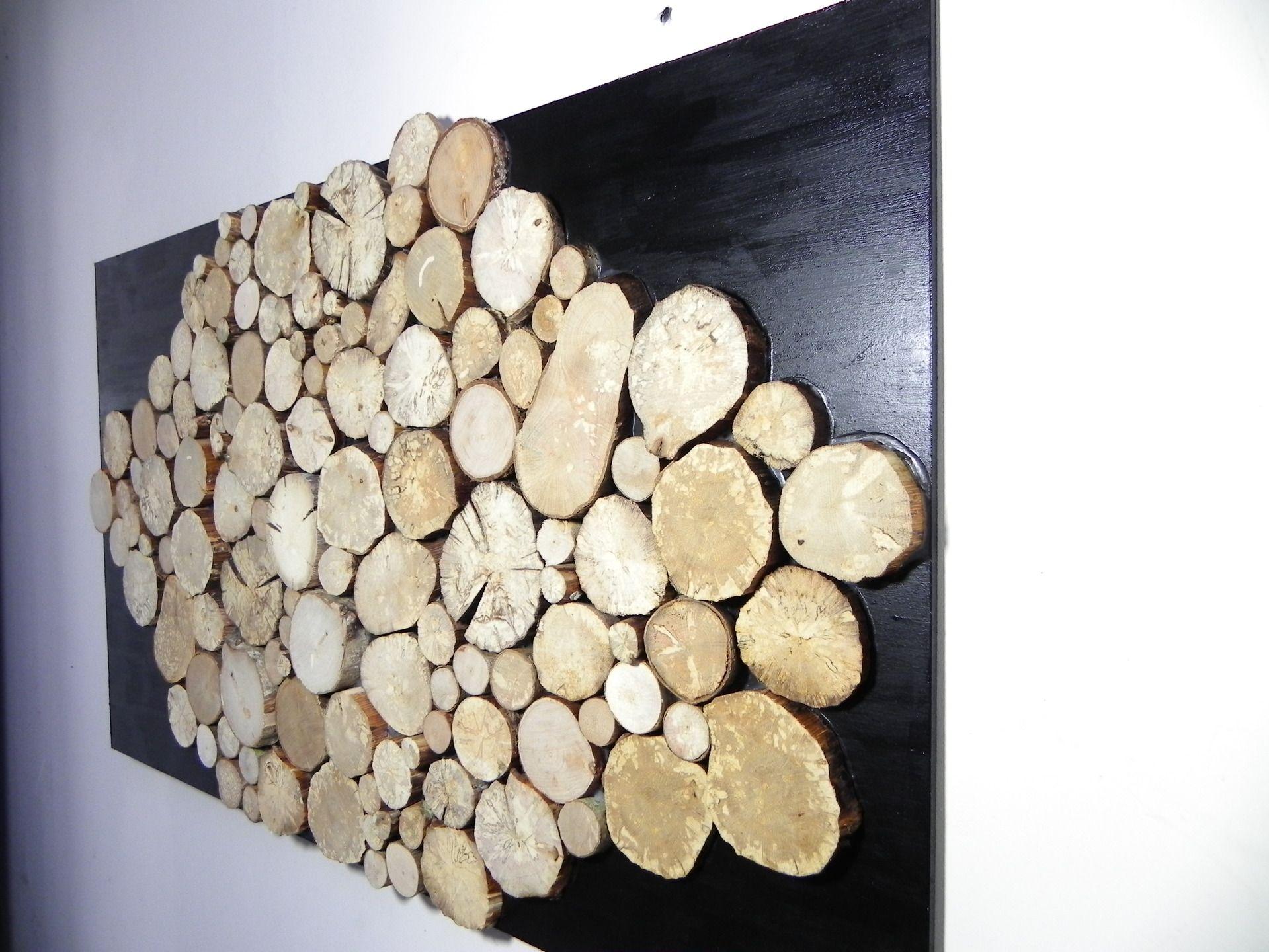 Grand tableau design abstrait en rondelles de bois brut sur