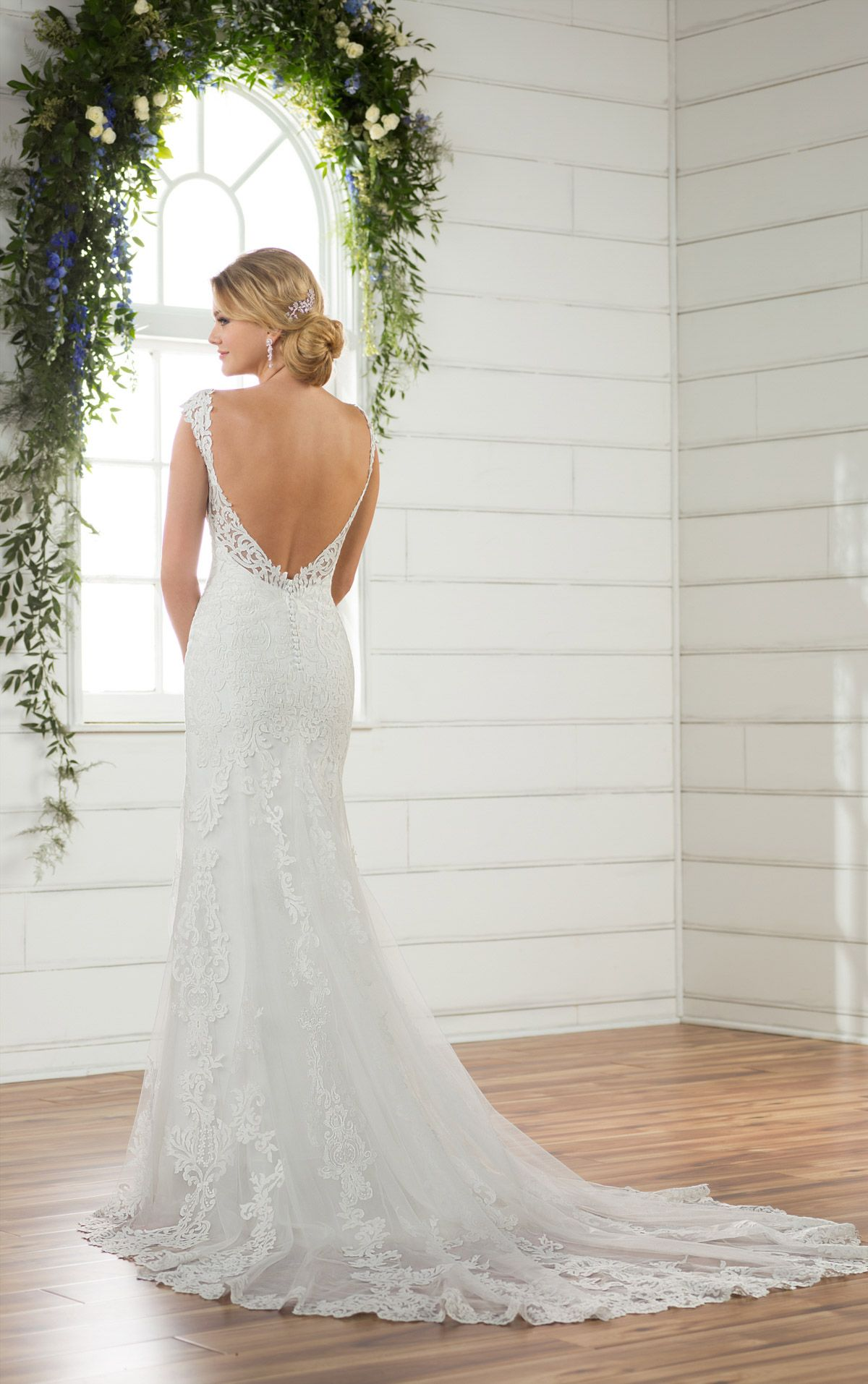 df11edc77a12 This backless wedding dress is the ethereal wedding dress brides love! A  relaxed column shape feels casual while remaining true to classic bridal  style.