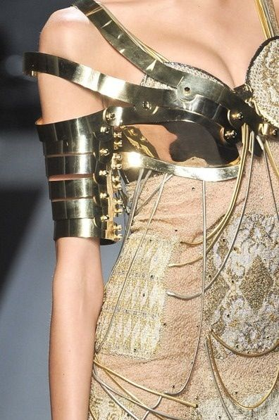 the armour style shoulder is metallic and segmented to give it a strong form (beetle like).