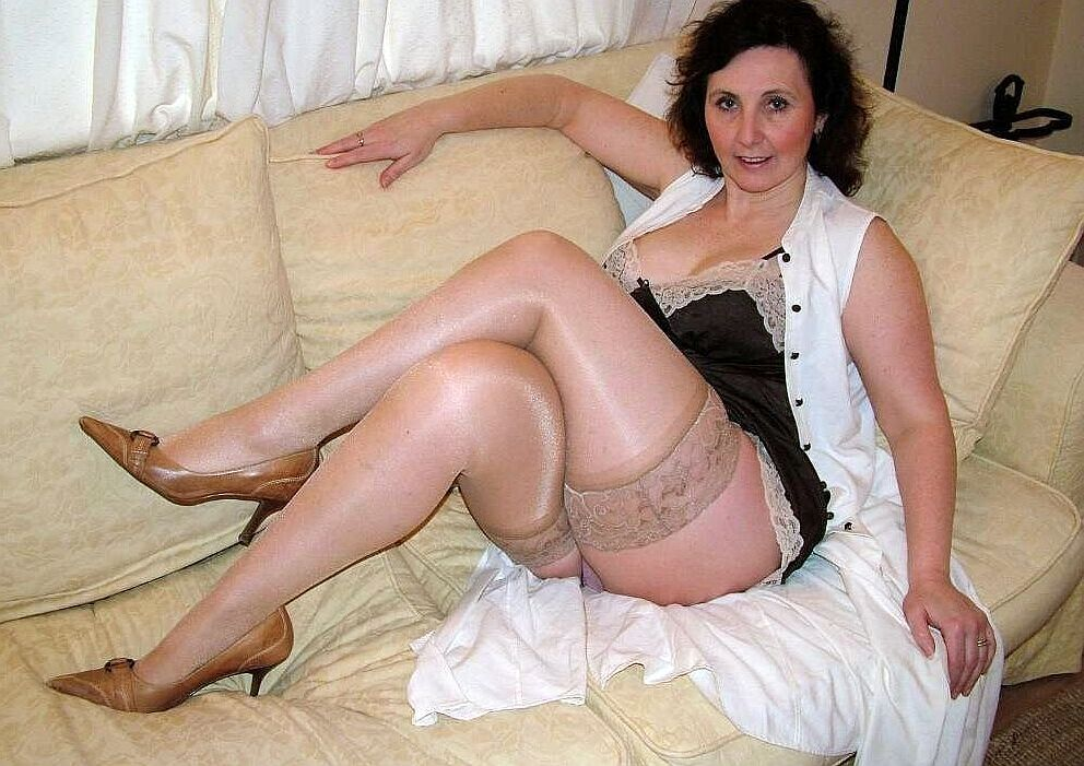 Older Woman Laying On Sofa In Black Lingerie And Sheer -8822