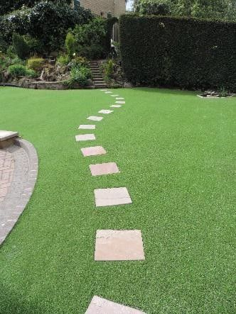 Stepping Stones Can Be Set Into Artificial Grass To Break Up The Area And Create A Focal Point Artificial Grass Grass Stepping Stones