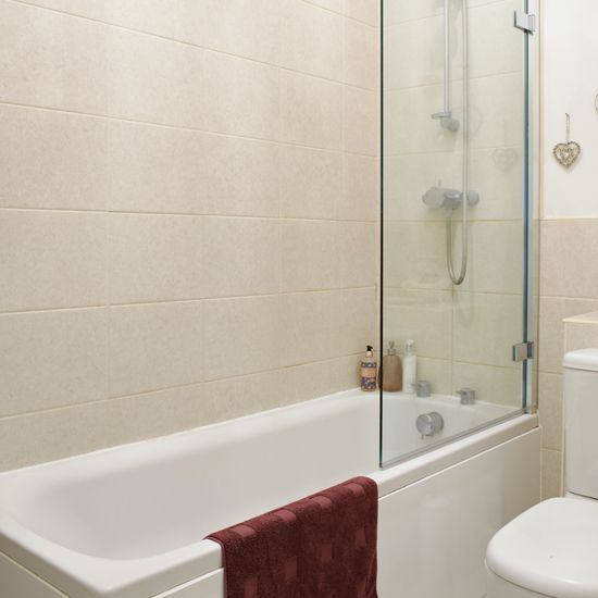 looking for bathroom decorating ideas check out this traditional scheme with cream tiles and white fittings and fixtures - Bathroom Tile Ideas Cream