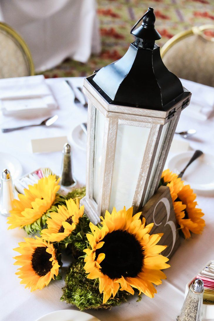 Rustic lantern and sunflower centerpiece for
