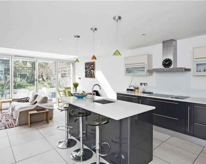 Photo Of Monochrome Open Plan Black White Chrome Kitchen With Island