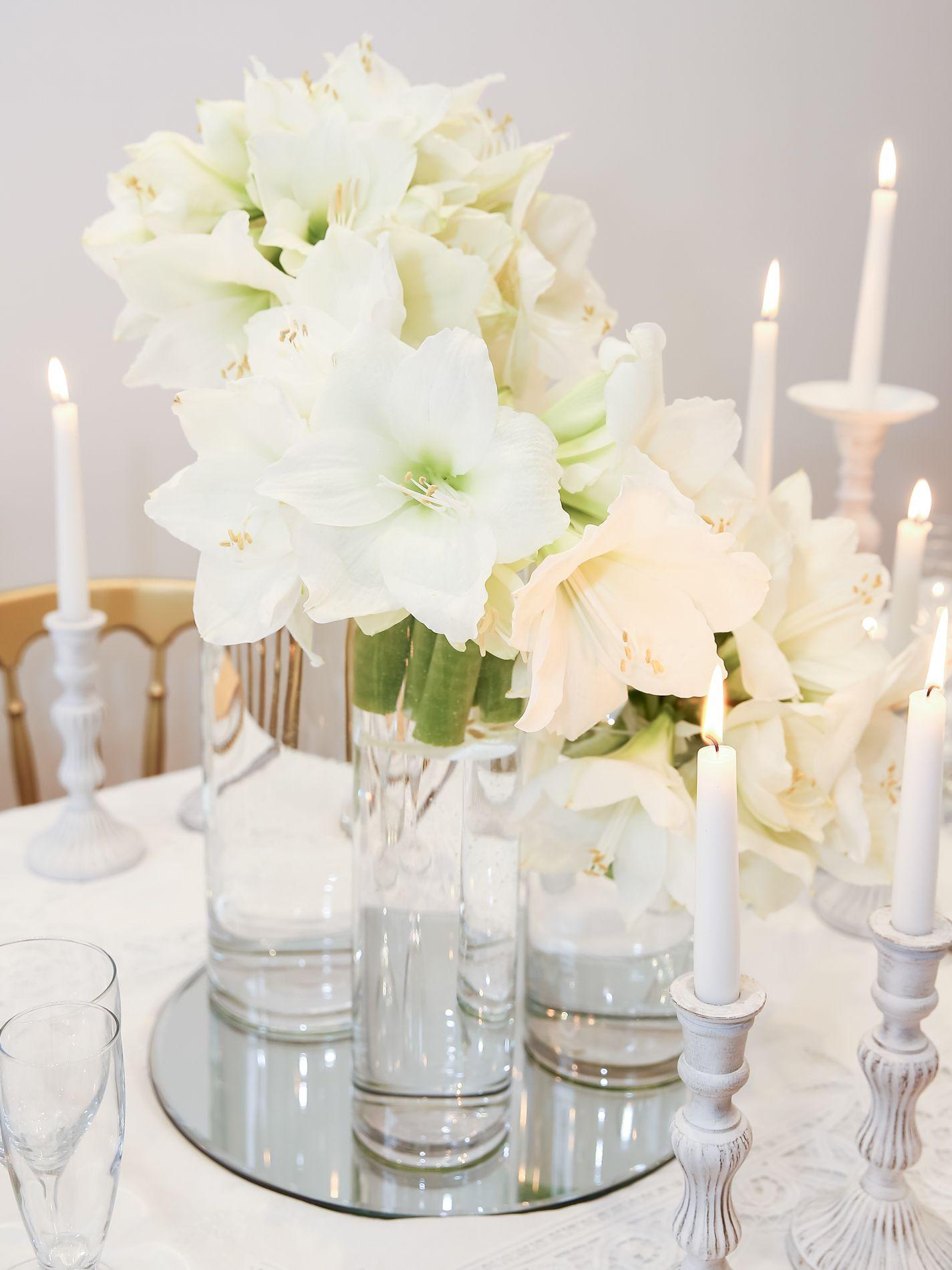 Beautiful cylinder vases of white amaryllis centrepiece and gold ...