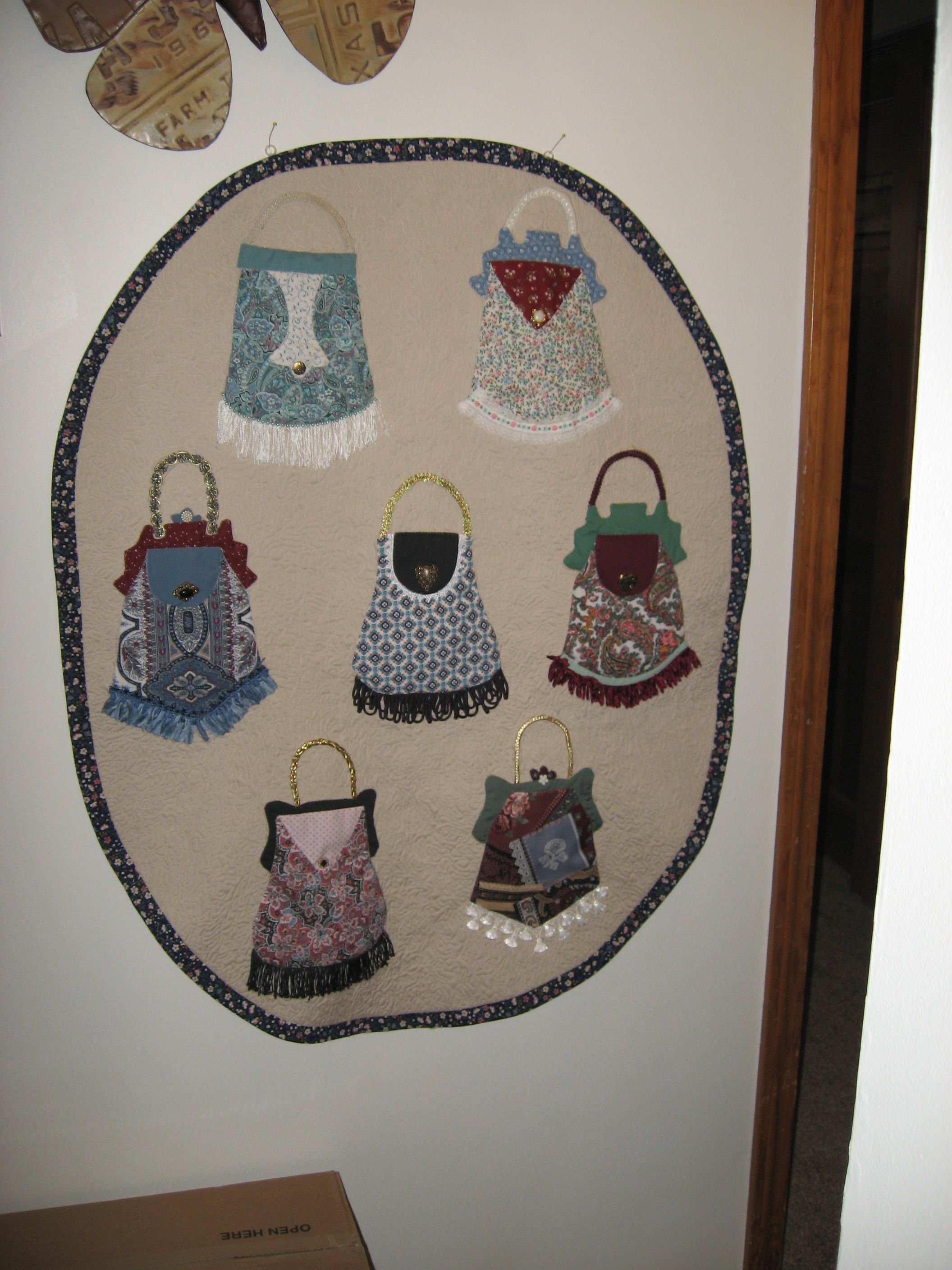 Purses quilted wall hanging I made. Recycled the purses from a jean jumper I had put them on years ago.  Put all the work in and didn't want it to go to waste.