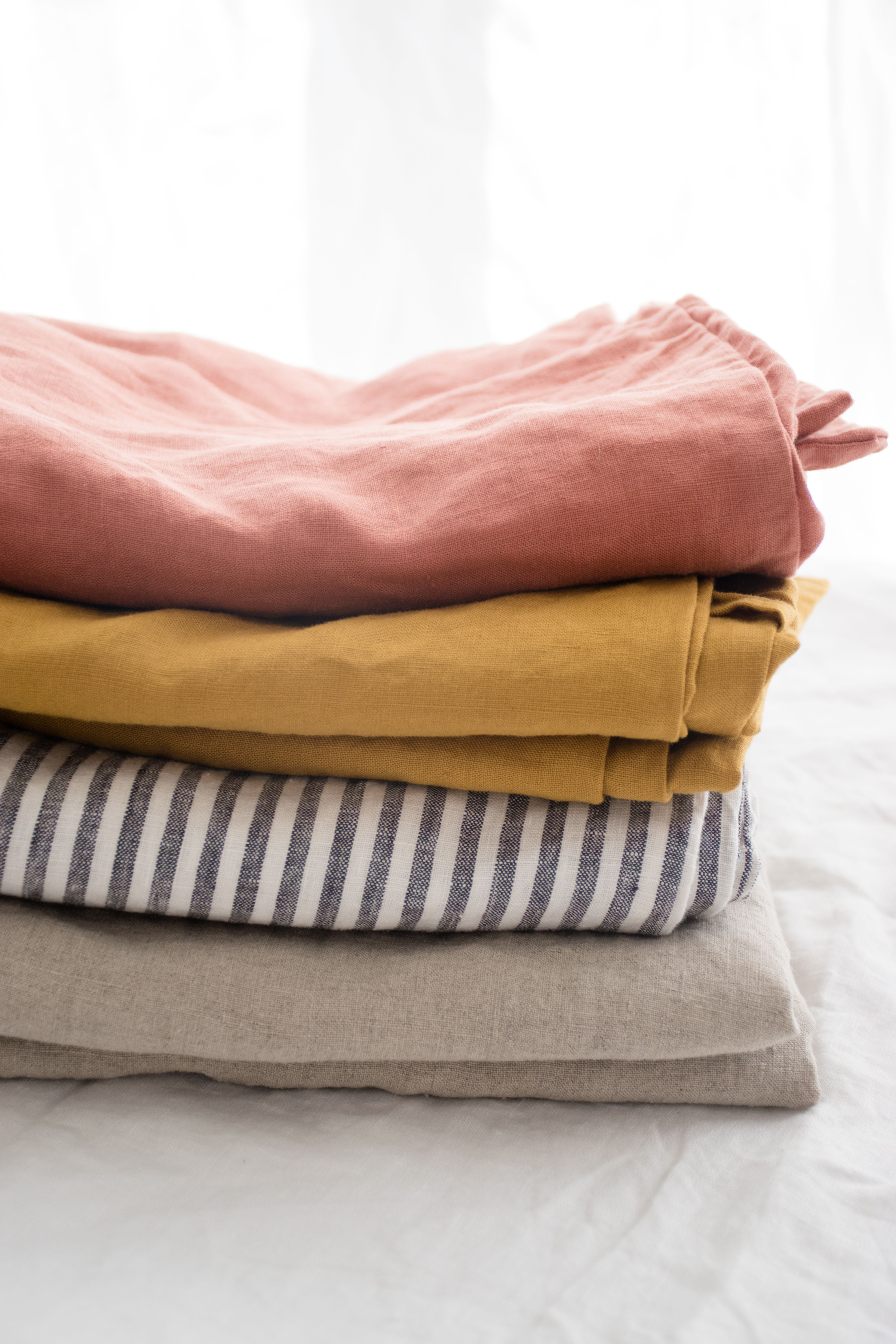 Stacks of stonewashed, French flax linen in our exclusive