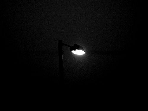 Snow around streetlight - black and white