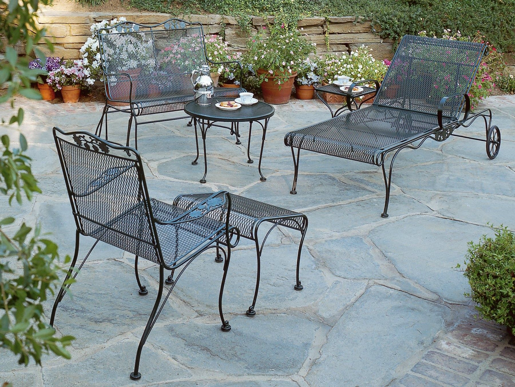 Gorgeous Patio Design Using Black Wrought Iron Chair And Round