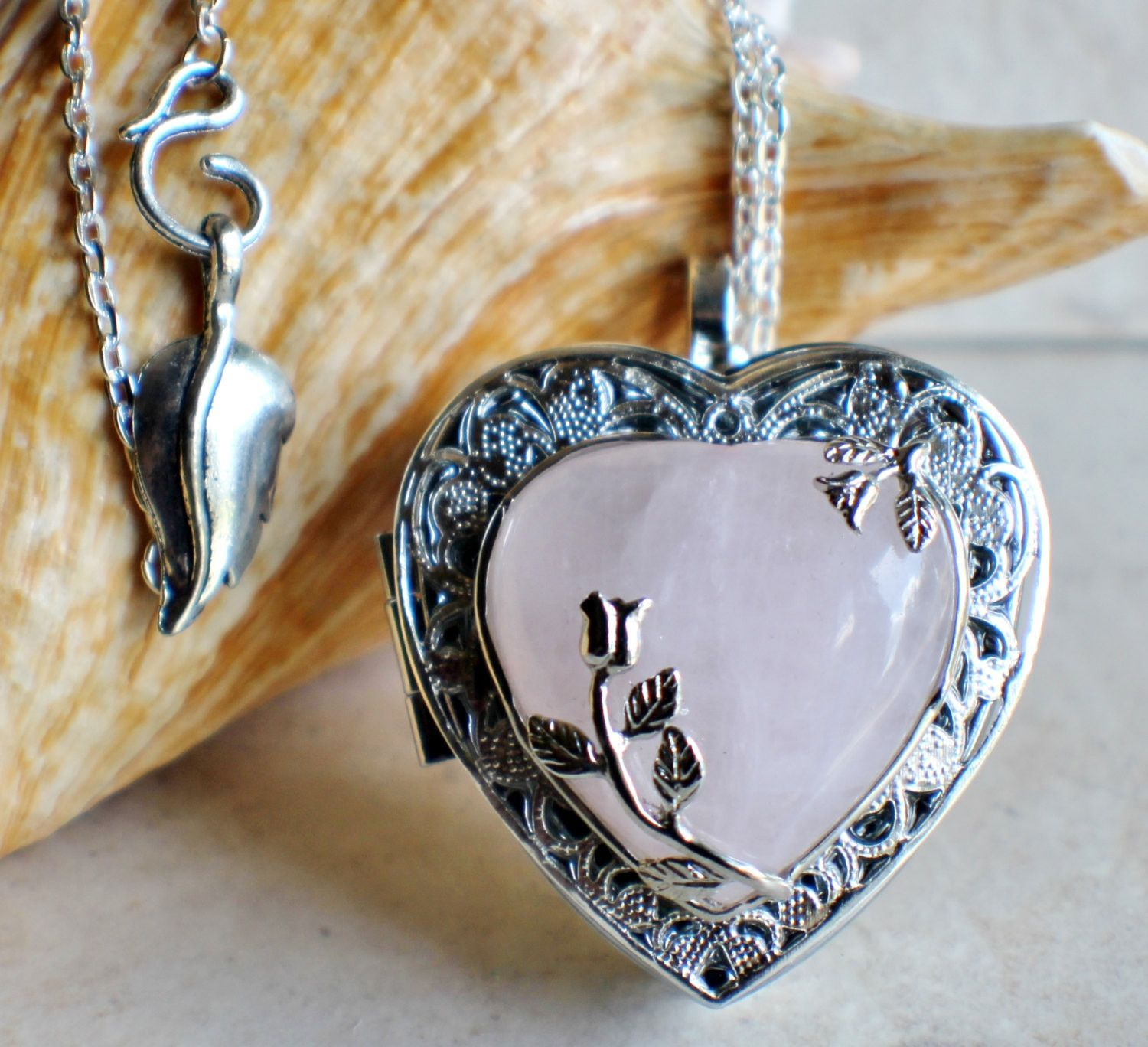Music box locket in silver tone with rose quartz crystal heart