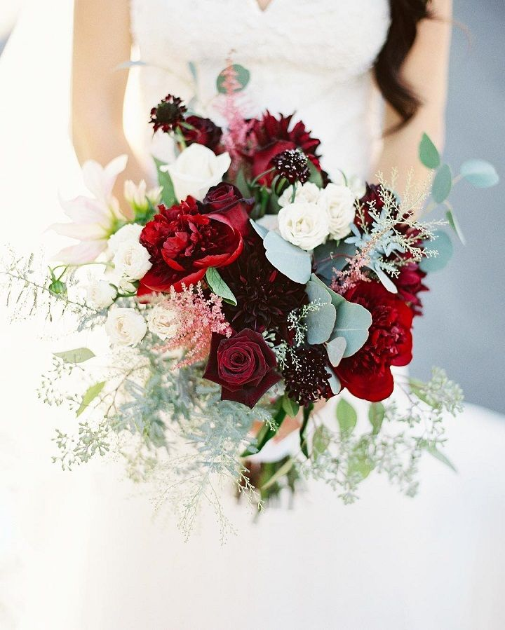 Gorgeous shades of red wedding color palette for an outdoor wedding , bridal bouquet