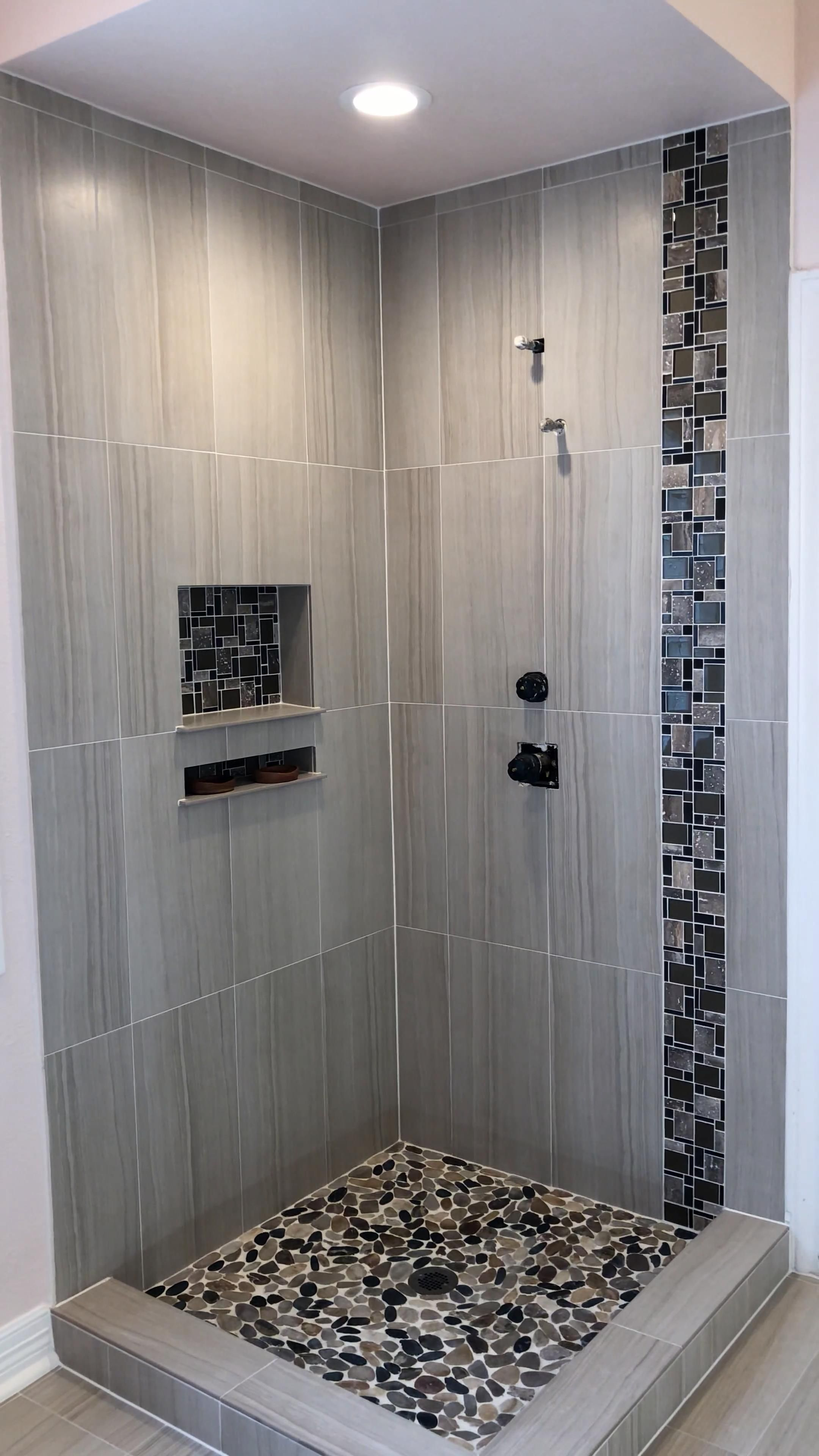 Photo of Bathroom renovation with light  color tile 12″×24″